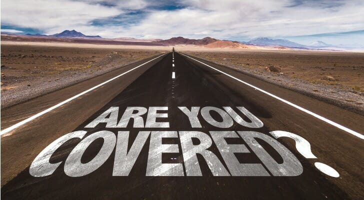"""ARE YOU COVERED"" written on a highway"